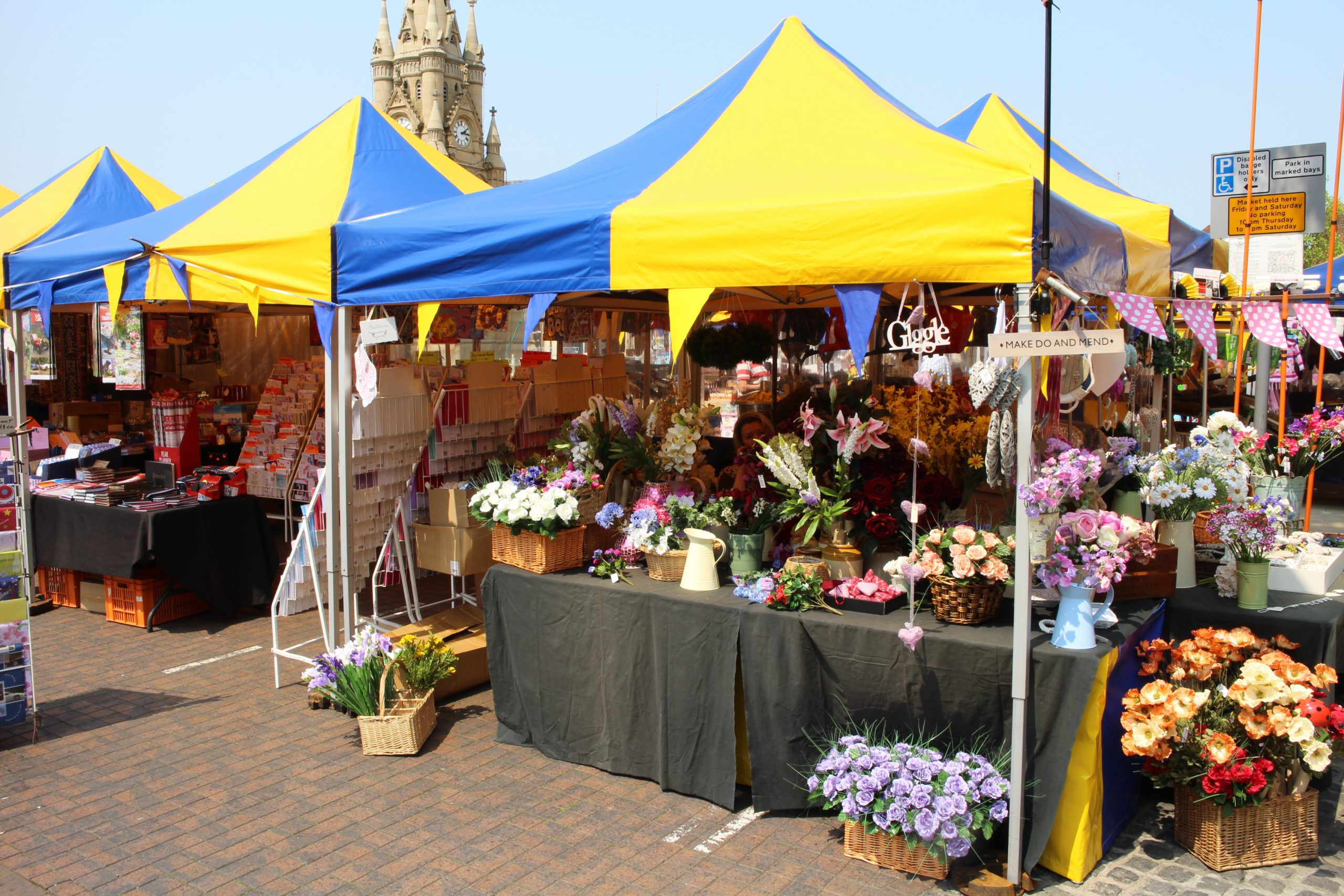 Instant Marquees market stalls at Stratford market. Sky blue and yellow.